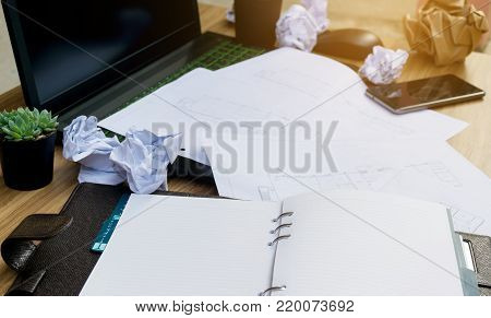Business mistake on the desk Working document paper Laptops Computer Notebook and Coffee