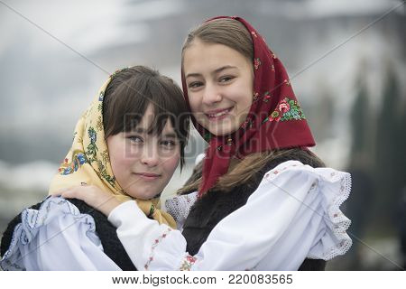 Barsana, Maramuresh/Romania - 12.25.2017: Two girls dressed in traditional Romanian clothes (Maramuresh region).