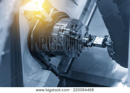The CNC lathe machine with the robot arm.Industrill 4.0 concept for modern manufacturing.