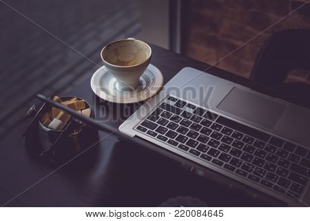 A laptop's keyboard and a cup of coffee. Imge for background use
