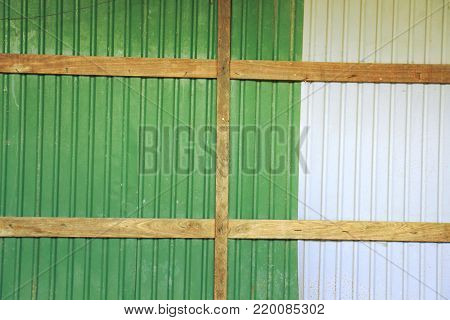 Rusted wall galvanized iron plate green with wood
