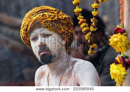 BABUGHAT, KOLKATA, WEST BENGAL / INDIA - 10TH JANUARY 2015 : Portrait of Hindu Sadhu aginst dark background.