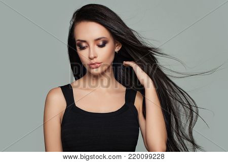 Pretty Woman Fashion Model with Long Healthy Hairstyle. Haircare Concept