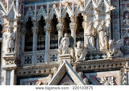 Siena Cathedral (Duomo di Siena) main facade details, completed in 1380. Siena is italian medieval town, capital of Siena province, Tuscany, Italy. Historic centre is UNESCO World Heritage Site.