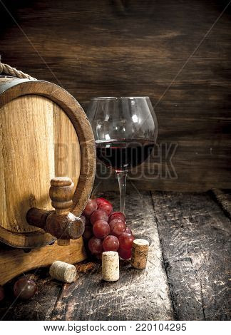 Barrel Of Red Wine With Grapes And A Corkscrew.