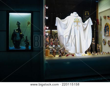 VIENNA, AUSTRIA - OCTOBER 14, 2005: Showcase of a church shop with religious items in Vienna on October 14, 2005.