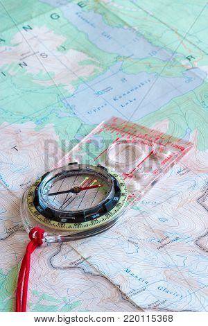 Compass on top of a topographic map