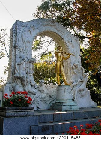 VIENNA, AUSTRIA - OCTOBER 15, 2005: Gold-plated statue of Austrian composer Johann Strauss in stadtpark in Vienna on October 15, 2005.