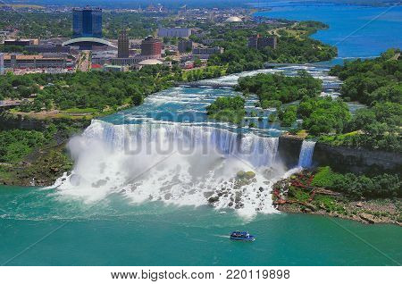 Niagara Falls from the US side, Bride Veil Falls. Boat with tourists moves along Bride Veil Falls.