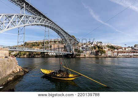 Porto, Portugal, August 15, 2017: Rabelo boats, one of the most popular symbols of Porto, used to carry barrels of Porto wine from the Douro valley vineyards to the Port Wine cellars.