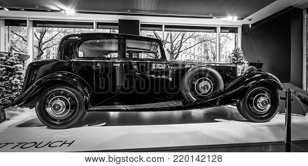 BERLIN - DECEMBER 21, 2017: Showroom. Luxury car Rolls-Royce Phantom II Continental Park Ward Touring Saloon, 1933. Black and white.
