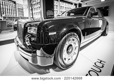 BERLIN - DECEMBER 21, 2017: Showroom. Full-size luxury car Rolls-Royce Phantom VII. Since 2003. Black and white.