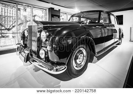 BERLIN - DECEMBER 21, 2017: Showroom. Ultra-exclusive four-door limousine Rolls-Royce Phantom V, 1961. Coachwork by Park Ward. Black and white.