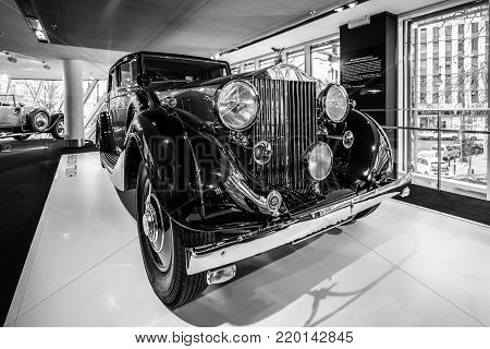 BERLIN - DECEMBER 21, 2017: Showroom. Luxury car Rolls-Royce Phantom III Touring Limousine, 1937. Coachwork by Gurney Nutting. Black and white.