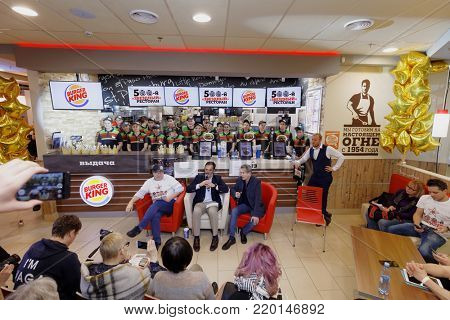 ST. PETERSBURG, RUSSIA - NOVEMBER 29, 2017: Press conference of Jose Cil (center), President of Burger King, and Dmitry Medovy, general director of Burger King Russia, in 500th restaurant in Russia