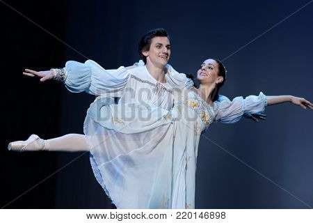 ST. PETERSBURG, RUSSIA - NOVEMBER 16, 2017: Soloists of Novosibirsk Opera and Ballet Theater Anna Germizeeva and Nikolay Maltsev perform during gala concert of great choreographer Oleg Vinogradov