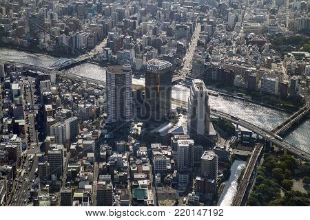 Tokyo -  Japan, June 19, 2017: Aerial view of Tokyo and the Asahi beer tower at the east bank of the Sumida River in Sumida, Tokyo