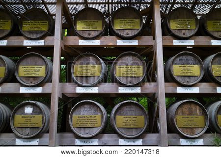 Tokyo -  Japan, June 18, 2017:  Wine barrels donated to the Meiji Jingu Shinto shrine by worshippers of the shrine in Shibuya, Tokyo