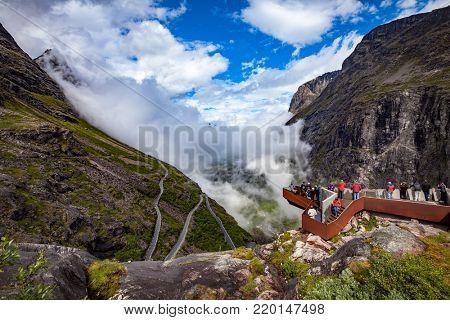 NORWAY: JULY 16, 2016: Viewing platform Troll's Path Trollstigen or Trollstigveien winding mountain road in Norway.