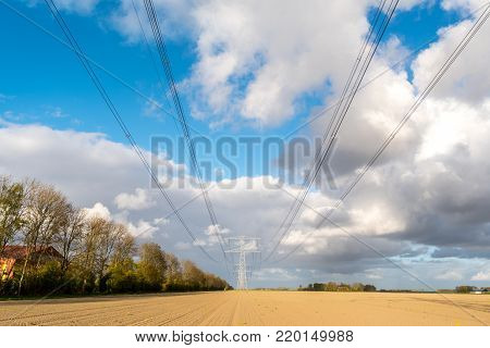 Large view on the modern high powerlines on the field
