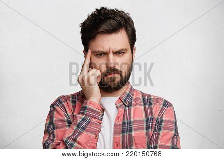 Headshot Of Stupefied Bug Eyed Male Model With Thick Beard And Mustache, Stares At Camera With Great