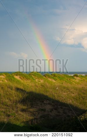 rainbow on the Atlantic over the dunes on the outer banks
