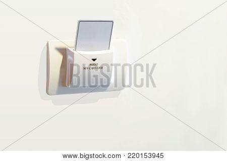 Insert key card in electronic lock in hotel