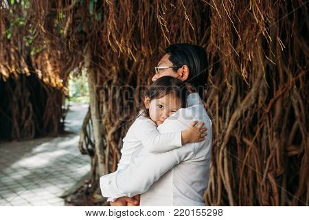 happy stylish asian father with little daughter walking in jungles park, amazing family moment. father's day mother's day