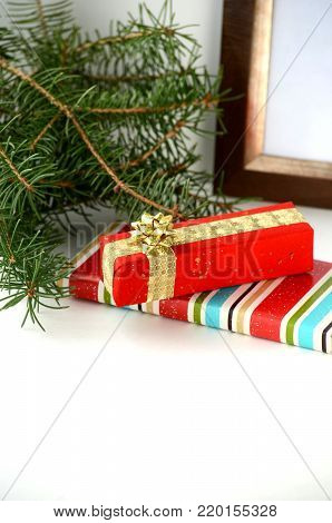 Beautifully wrapped Christmas gifts and presents. Gift box in a luxurious wrapping paper with copy space.