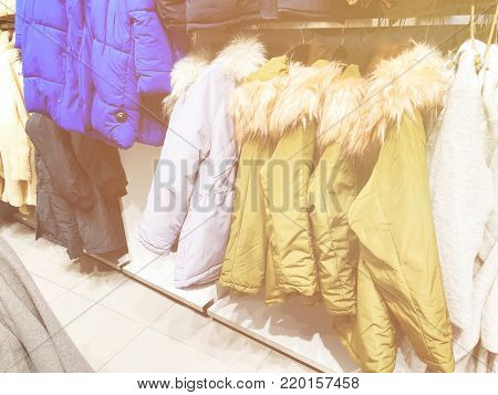 Men's and women's jackets and down jackets on the counter in the store