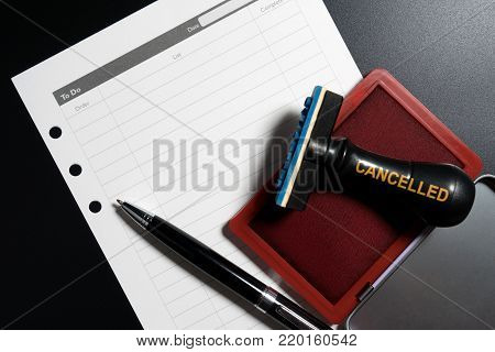 Red Stamp With Text Cancelled On To Do List Table On Business Blackground. Reminder To Cancel Busine