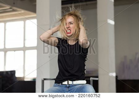 The Abuld Woman Shouts Hysterically. Portrait of a Nrvous Woman