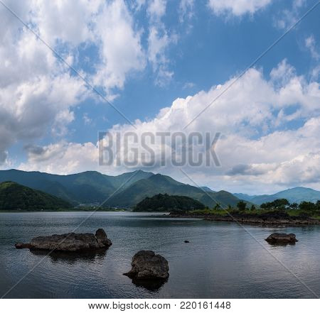 Rocky volcanic shores of the Kawaguchi lake, Japan
