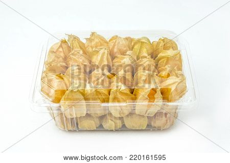 Gooseberries in plastic box  or Golden gooseberries in plastic container on white background. Front of plastic box.