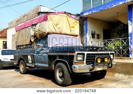 Emiliano Zapata, Mexico - May 23, 2017: Aged pickup truck Ford F-series in the city street.