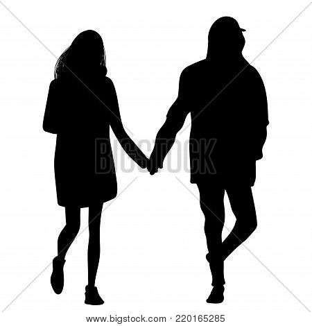 Silhouette of a girl and a young man walking alongside hand in hand
