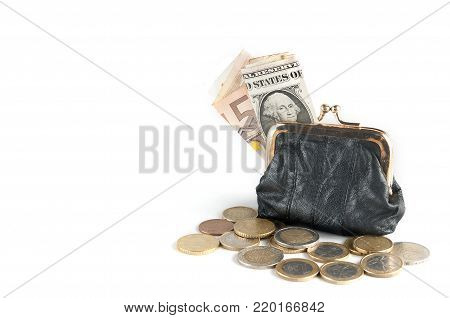 A leather coin purse with banknotes (euro and dollar) and coins isolated