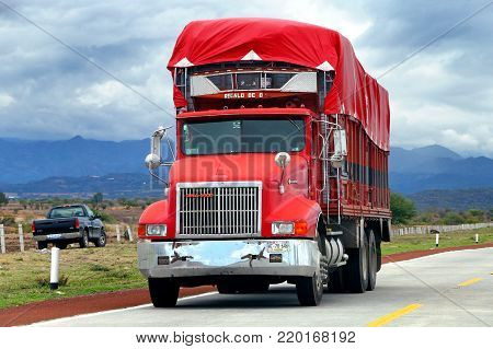 Puebla, Mexico - June 1, 2017: Red agricultural truck Dina 9400 at the interurban road.
