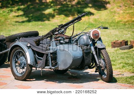 Old Tricar, Three-Wheeled Motorbike With The Machine Gun On Sidecar Of Wehrmacht, Armed Forces Of Nazi Germany Of World War 2 Time In Summer Sunny Park.