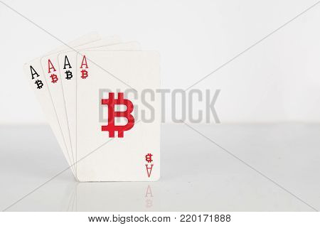 Bitcoin concept: four of a kind of bitcoin playing cards