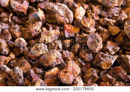 Red color of Iron oxide on gravel surface of broken laterite stone