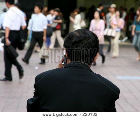 Japanese Salaryman Having A Business Talk