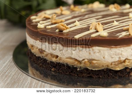 Sweet chocolate cake with peanuts, snickers cake