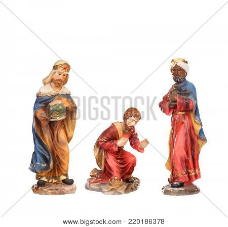 The three wise men. Ceramic figures isolated on white background