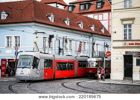 Prague, Czech Republic - July 21, 2014: Modern articulated tramway Skoda 14T Elektra in the old city street.