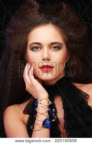 Beautiful young woman with magnificent hairdo, close up