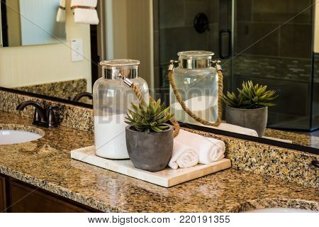 Modern Bathroom With Glass Jar On Granite Counter