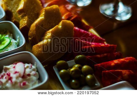 White Wine In A Glass With Appetizers On A Wooden Table, A Set Of Starters, Relax With A Glass Of Wi