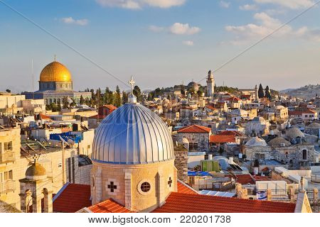 A view on rooftops of Old City of Jerusalem. Grey dome of Church of Our Lady of the Spasm (Armenian church) and golden Dome of the Rock. poster