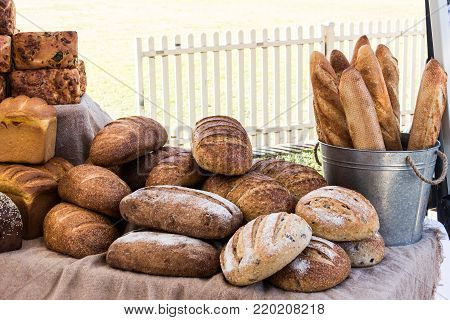 Loaves of freshly baked wholemeal and sourdough bread